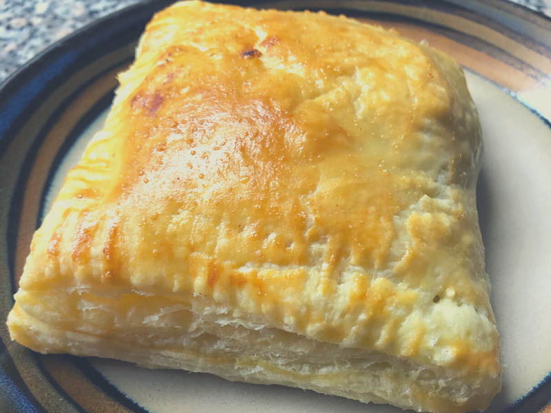 golden crust of beef empanada using puff pastry